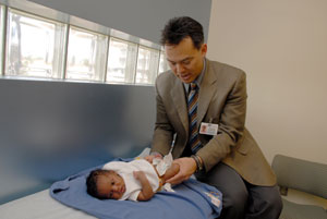 Dr. Bowen examining pediatric patient